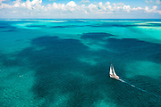 Helicopter view of cruising abourd 110ft Tenacious in the Exumas, Bahamas