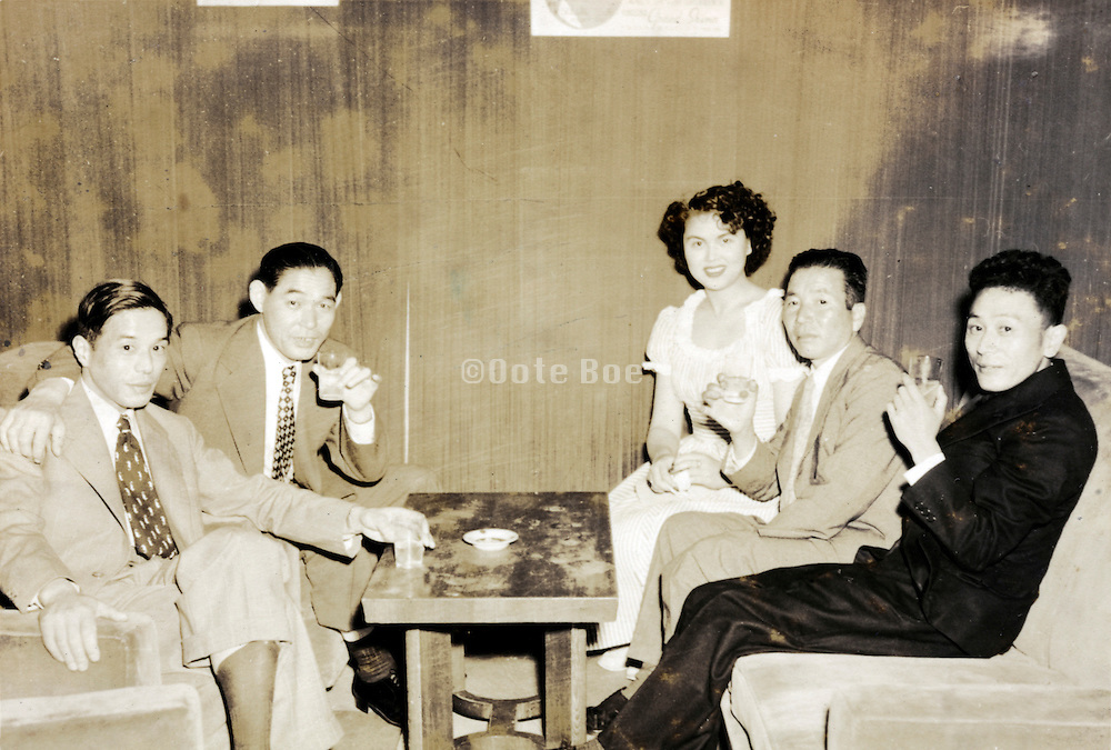 Tokyo bar with fashionable dressed woman in western style cabaret dance hall Japan 1960s