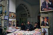 Baku, Azerbaijan, April 1999.&#xD;Newspaper seller surrounded by portraits of Azeri President Heidar Aliyev.&#xD;&#xD;&#xD;&#xD;&#xD;&#xD;&#xD;&#xD;&#xD;&#xD;&#xD;<br />