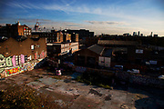 View from Hackney Wick looking East towards the Olympic site over grafitti and waste ground.