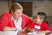 University of Arkansas students teachers help with enrollment at Harp Elementary in Springdale
