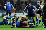 Leinster's Rob Kearney © is tackled by Richard Hibbard of the Ospreys.Heineken cup rugby, pool 1 match, Ospreys v Leinster rugby at the Liberty stadium in Swansea on Sat 12th October 2013 pic by Andrew Orchard, Andrew Orchard sports photography,