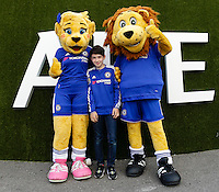 A young fan poses with the home side's mascots, outside Stamford Bridge, home of Chelsea<br /> <br /> Photographer Craig Mercer/CameraSport<br /> <br /> Football - Barclays Premiership - Chelsea v Swansea City - Saturday 8th August 2015 - Stamford Bridge - London<br /> <br /> © CameraSport - 43 Linden Ave. Countesthorpe. Leicester. England. LE8 5PG - Tel: +44 (0) 116 277 4147 - admin@camerasport.com - www.camerasport.com