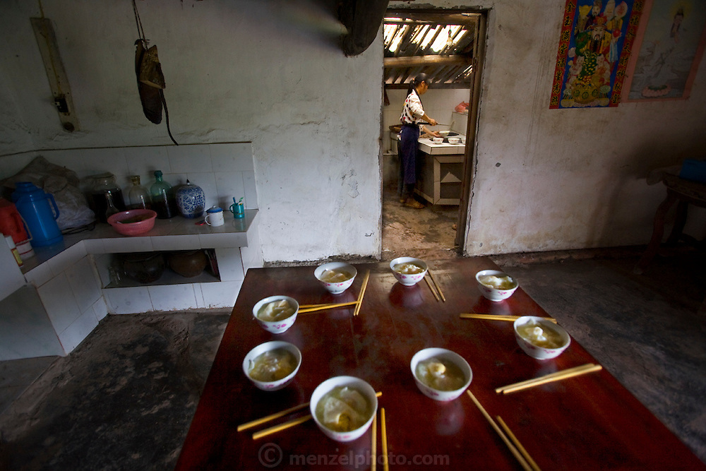 The table is set for lunch at the home of widowed farmer Lan Guihua, who lives in Ganjiagou Village, Sichuan Province, China. (From the book What I Eat: Around the World in 80 Diets.) In this region, each rural family is its own little food factory and benefits from thousands of years of agricultural knowledge passed down from generation to generation.
