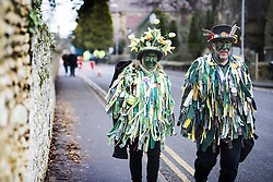 January 14, 2017 - Whittlesey, Cambridgshire, UK - Whittlesey UK. Picture shows members of the Bourne Borderers Molly dancers at the 38th Whittlesey Straw Bear fesitval this weekend. In times past when starvation bit deep the ploughmen of the area where drawn to towns like Whittlesey, They knocked on doors begging for food & disguised their shame by blackening their faces with soot. In Whittlesey it was the custom on the Tuesday following Plough Monday to dress one of the confraternity of the plough in straw and call him a Straw Bear. The bear was then taken around town to entertain the folk who on the previous day had subscribed to the rustics, a spread of beer, tobacco & beef. The bear was made to dance in front of houses & gifts of money, beer & food was expected. (Credit Image: © Andrew Mccaren/London News Pictures via ZUMA Wire)