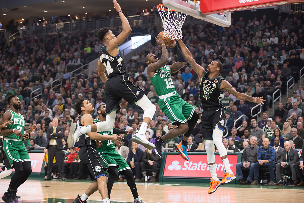 Giannis Antetokounmpo gets sky high to block Terry Rozier for the Milwaukee Bucks' game against the Boston Celtics February 21, 2019.