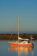Sailboat anchored in the still calm water of Morro Bay, California
