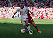 Leeds United FC defender Charlie Taylor  clears the ball under pressure during the Sky Bet Championship match between Middlesbrough and Leeds United at the Riverside Stadium, Middlesbrough, England on 27 September 2015. Photo by George Ledger.