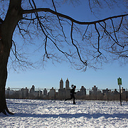 A jogger in Central Park after New York City was hit with over 7 inches of snow during its first winter storm of the year. Central Park, Manhattan, New York, USA. 4th January 2014 Photo Tim Clayton