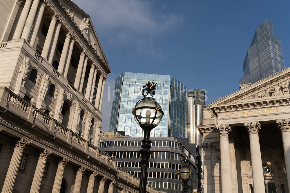 Days before the Chancellor Rishi Sunak delivers his Budget, a wide view of the Bank of England left and Royal Exchange right in the City of London, the capitals financial district, on 1st March 2021, in London, England.