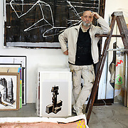 4 Dec 2007 - New York, New York - French musician CharlElie Courture works in his studio in the Garment District.  Courture moved to New York in 2004 to pursue his painting.  Photo Credit: Lori Hawkins/Sipa Press.