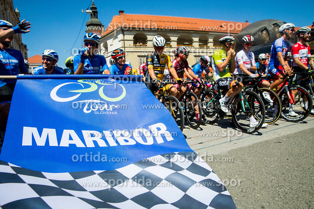 The flag and cyclists during 2nd Stage of 26th Tour of Slovenia 2019 cycling race between Maribor and  Celje (146,3 km), on June 20, 2019 in Celje, Maribor, Slovenia. Photo by Vid Ponikvar / Sportida