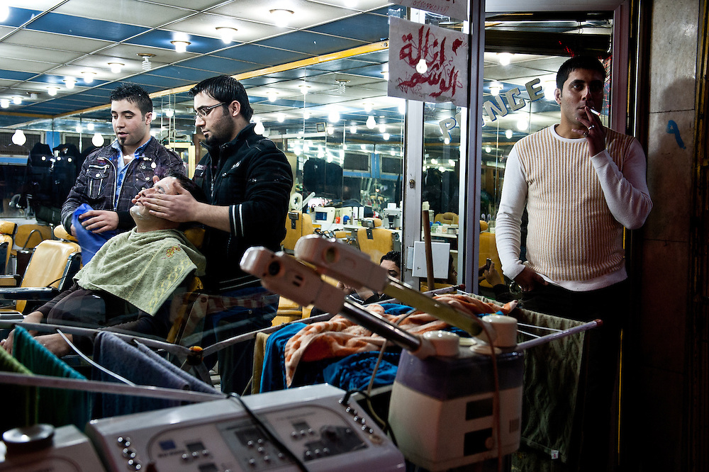 A barber shop at night in Baghdad.