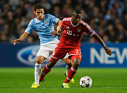 Bayern Midfielder David Alaba (AUT) is tackled by Man City Midfielder Jesus Navas (ESP)  during the first half of the match - Photo mandatory by-line: Rogan Thomson/JMP - Tel: Mobile: 07966 386802 - 02/10/2013 - SPORT - FOOTBALL - Etihad Stadium, Manchester - Manchester City v Bayern Munich - UEFA Champions League Group D.
