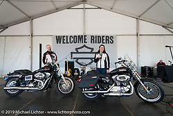 Harley-Davidson's staff describe the attributes of the just introduced HD 1200T Sportster and the new Low Rider at the Harley-Davidson Display during Daytona Bike Week. FL, USA. March 8, 2014.  Photography ©2014 Michael Lichter.