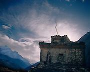 Chorten and storm clouds. Kagbeni Village. Annapurna trek, Nepal