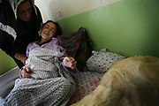 Khalisa, far left, assists Qamar, a 26-year-old tuberculosis patient from Shohada district, as she suffers from complications at Faizabad Provincial Hospital, Faizabad in Badakshan province, Afghanistan, Sunday, May 13, 2007.