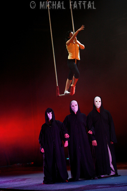 """The Palestinian Circus School members perform during the show """"Circus behind the wall"""" in Ramallah, November 20, 2009. The circus group was established in 2006, in order to give a new way of expression for Palestinians, and a new way to deliver the idea of resistance to the occupation. This performance is based on the life of Palestinians behind the separation wall."""