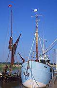 AT5BRF Sailing barge and boat moored quayside Snape maltings Suffolk England