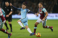 David Silva of Manchester City © goes past Mark Noble of West Ham Utd . Premier league match, West Ham Utd v Manchester city at the London Stadium, Queen Elizabeth Olympic Park in London on Wednesday 1st February 2017.<br /> pic by John Patrick Fletcher, Andrew Orchard sports photography.