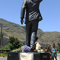 PAARL, SOUTH AFRICA - Sunday 8 December 2013, visitors place flowers at the statue of Nelson Mandela at the entrance of the Groot Drakenstein Prison formerly known as the Victor Verster Prison in Paarl, just outside of Cape Town. The statue is at the place Nelson Mandela walked out of prison, a free man, on 11 February 1990.<br /> Photo by Roger Sedres/ImageSA
