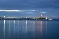 Long exposure showing lights on Mackinac Bridge at twilight, seen from Mackinaw City Michigan.