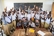 The VSO ICS volunteers pose with students to celebrate completing their project at Mingoyo school as part of the VSO / ICS Elimu Fursa project (Opportunities in Education) Lindi, Lindi region. Tanzania.