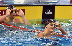 Vladimir Morozov (R) of Russia celebrates after winning Men's 100m Freestyle Final of FINA/airweave Swimming World Cup Doha 2017 at the Hamad Aquatic Centre in Doha , capital of Qatar on October. 04, 2017. Vladimir Morozov claimed the title with 49.92 seconds. (Xinhua/Nikku (Credit Image: © Nikku/Xinhua via ZUMA Wire)