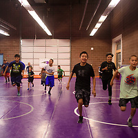 Campers running sprints at the Morningside Wrestling Camp run by Alias Starkovich, Tuesday July 25 at Miyamura High School. Starkovich brought the camp to Gallup because he wanted to give back to the wrestling program and community here.