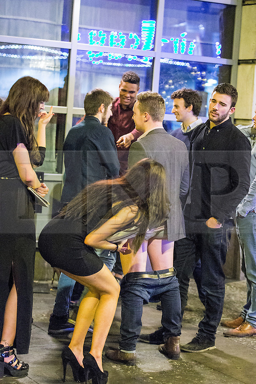 © Licensed to London News Pictures . 01/01/2015 . Manchester , UK . A man with his trousers down , outside Tiger Tiger on Withy Grove . Revellers usher in the New Year on a night out in Manchester City Centre .  Photo credit : Joel Goodman/LNP