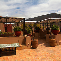Africa, Morocco, Asni. Terraces at Richard Branson's Kasbah Tamadot luxury retreat in the Atlas Mountains.