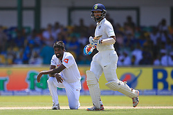 August 3, 2017 - Colombo, Sri Lanka - Sri Lankan cricketer Nuwan Pradeep(L) kneels down in reaction to a misfield as Indian cricketer Cheteshwar Pujara(R) looks on during the 1st Day's play in the 2nd Test match between Sri Lanka and India at the SSC international cricket stadium at the capital city of Colombo, Sri Lanka on Thursday 03 August 2017. (Credit Image: © Tharaka Basnayaka/NurPhoto via ZUMA Press)
