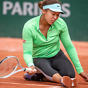PARIS, FRANCE May 25. Naomi Osaka of Japan slips while practicing on Court Simonne Mathieu in preparation for the 2021 French Open Tennis Tournament at Roland Garros on May 25th 2021 in Paris, France. (Photo by Tim Clayton/Corbis via Getty Images)