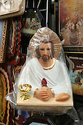 Christ under plastic and other Jesus paraphernalia, Cuernavaca, Morelos,  Mexico.