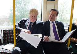 The Mayor of London Boris Johnson and Prime Minister David Cameron sit on an underground train as they head to Westminster after visiting Harrow Skills Centre and meeting local shoppers in Harrow town centre as they took to the campaign trail together.