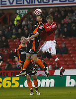 Photo: Richard Lane/Richard Lane Photography. Nottingham Forest v Blackpool. Coca Cola Championship. 13/12/2008. Shaun Barker (L) wins the ball in the air from Joe Garner (R)