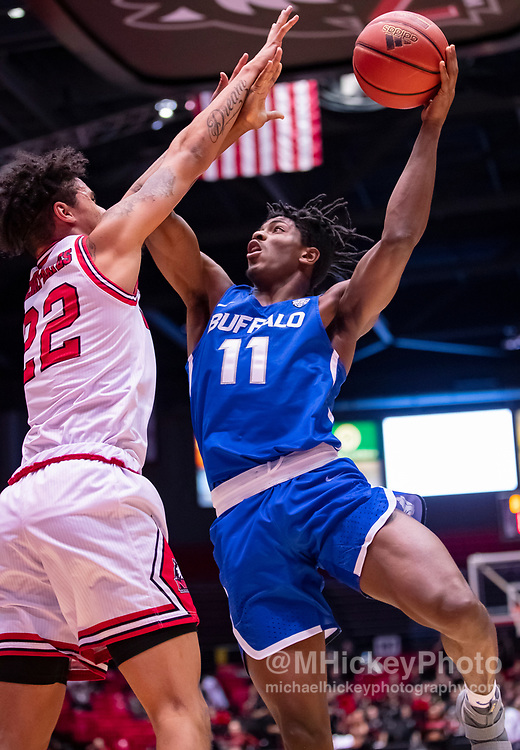 DEKALB, IL - JANUARY 22: Jeenathan Williams #11 of the Buffalo Bulls shoots the ball against Rod Henry-Hayes #22 of the Northern Illinois Huskies at NIU Convocation Center on January 22, 2019 in DeKalb, Illinois. (Photo by Michael Hickey/Getty Images) *** Local Caption *** Jeenathan Williams; Rod Henry-Hayes