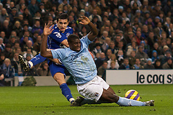 MANCHESTER, ENGLAND - Monday, February 25, 2008: Everton's Tim Cahill sees his shot blocked by Manchester City's Micah Richards during the Premiership match at the City of Manchester Stadium. (Photo by David Rawcliffe/Propaganda)