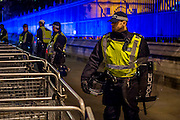 """Riot police with dogs and shields guard buckingham Place and Westminster - The Million Mask March - anti-establishment protesters in V for Vendetta-inspiredGuy Fawkes masks march from Trafalgar Square to Parliament Square. It was organised by Anonymous, the anarchic 'hacktivist' network. The movement is also closely identified with the Occupy protests, Wikileaks, and the Arab Spring. The UK Anonymouswebsitedescribes the march on Parliament as a """"protest against austerity … the infringement of our rights … mass surveillance … war crimes … corrupt politicians."""" 05 Nov 2016"""