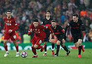 Alex Oxlade-Chamberlain of Liverpool runs clear of the Atletico defence during the UEFA Champions League match at Anfield, Liverpool. Picture date: 11th March 2020. Picture credit should read: Darren Staples/Sportimage