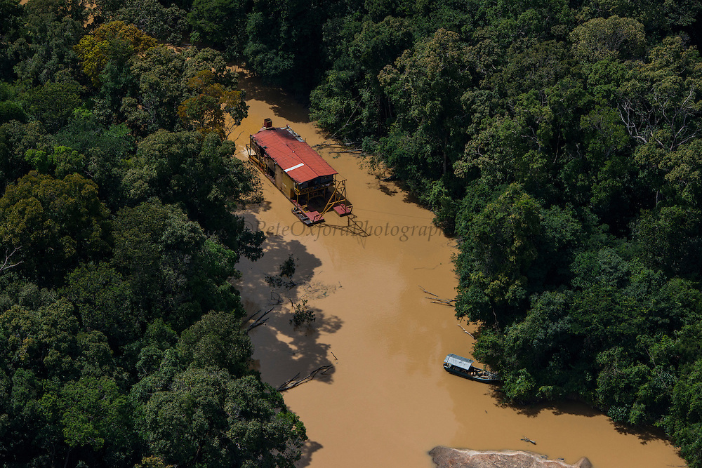 Gold Dredger<br /> Cuyuni River<br /> GUYANA<br /> South America<br /> Longest river in Guyana