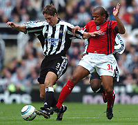 Photo: Back Page Images. 25/09/2004.<br /> Barclays Premiership. Newcastle United v W.B.A.<br /> Robbie Elliot and Robbie Earnshaw