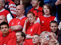 Photo: Daniel Hambury.<br />Arsenal v Wigan Athletic. The Barclays Premiership. 07/05/2006.<br />An Arsenal fan sheds a tear at the end.