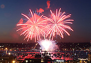 Fireworks illuminate Lake Union and the surrounding neighborhood in this view from the roof of The Seattle Times. <br /> Dean Rutz / The Seattle Times