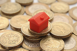 Embargoed to 0001 Monday May 22 File photo dated 27/01/15 of a plastic model of a house on a pile of one pound coins, as house sellers' asking prices reached a new record high in May amid signs that people's moving needs are taking priority over uncertainty surrounding Brexit and the forthcoming General Election, according to a website.