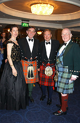 Left to right, LADY NOBLE, PETER MATHER, LORD BIDDULPH and SIR IAN NOBLE at the annual Royal Caledonian Ball in aid of The Royal Caledonian Ball Trust held at The Grosvenor House Hotel, Park Lane, London W1 on 28th April 2005.<br /><br />NON EXCLUSIVE - WORLD RIGHTS