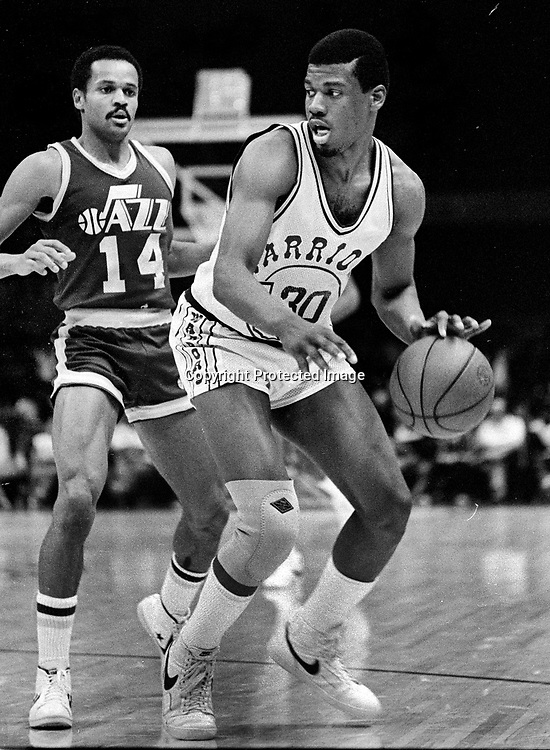 Golden State Warrior Bernard King with Jazz #14 Rickey Green. <br />