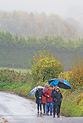 ©Licensed to London News Pictures 29/10/2020  <br /> Swanley, UK. A family with their umbrellas up out walking near Eynsford in Kent. October is set to be the wettest month in years as an Atlantic storm brings wet and windy weather to parts of the UK today. Photo credit:Grant Falvey/LNP