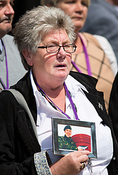 © Licensed to London News Pictures. 06/07/2016. London, UK. Dawn Holmes cries on the day Sir John Chilcot's Report of the Iraq Inquiry is published. The Inquiry was predicated to take approximately one year, but has taken seven. Photo credit : Tom Nicholson/LNP