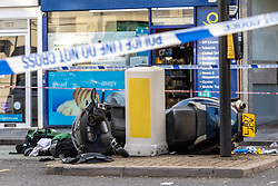 Licensed to London News Pictures. 24/08/202. London, UK. Emergency services at the scene  of a crash involving a car and motorbike on Putney High Street, southwest London where a car collided with a motorcycle leaving the motorcyclist fighting for his life. There are reports that there was an ongoing police investigation, including a police pursuit team following one of the vehicles at the time of the crash. Photo credit: Alex Lentati/LNP